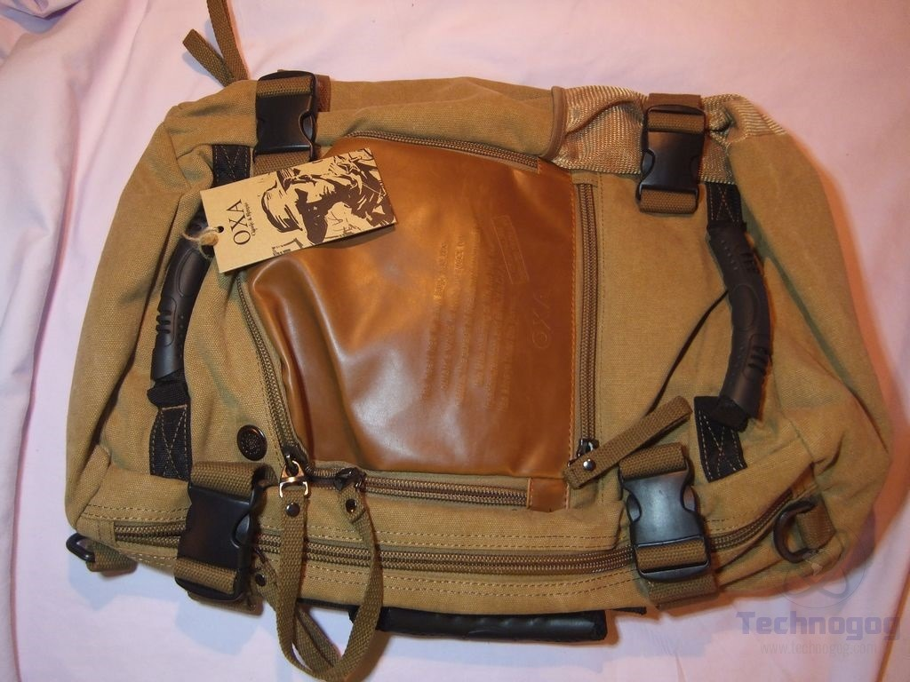Below the leather section is a small pocket about 5.5 inches by 8 inches in  dimensions f073c4e5dc37a