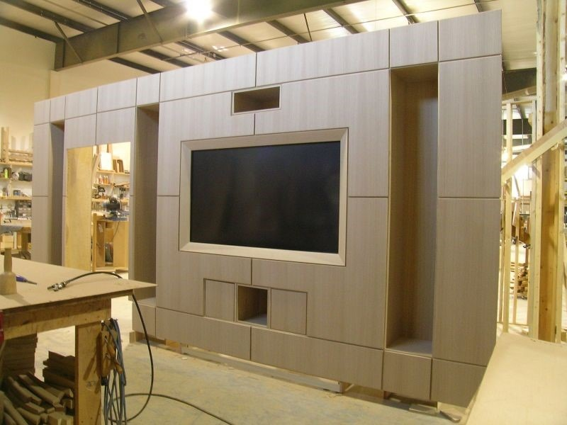 plywood which is painted would close over the tv when retracted to prevent the door having direct contact with the plastic bezels felt pads are added