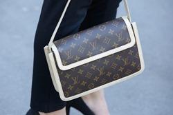 PARIS - SEPTEMBER 30: Louis Vuitton bag before Rochas show, Paris Fashion Week Day 2, Spring / Summer 2016 street style on September 30, 2015 in Paris.