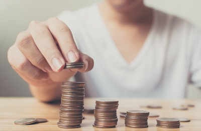 Man hands putting coins stack, Concept business finance save money and investment