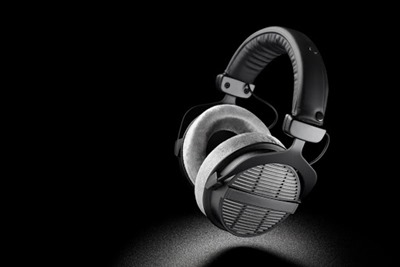 Headphones. Professional over-ear open back earphones on black background